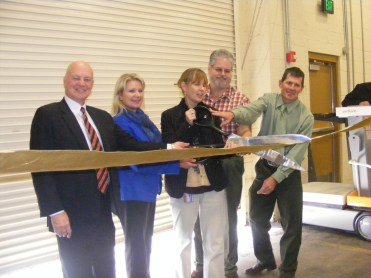 Photograph of 5 individuals cutting the ribbon at the Utah State Records Center Ribbon Cutting, 2012.