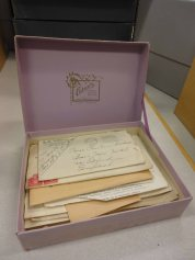 A box of letters, waiting to be read.