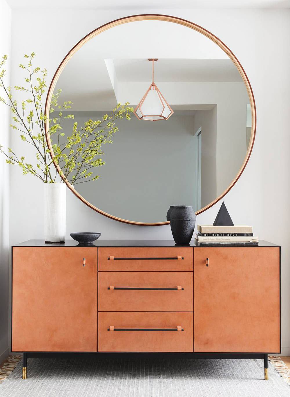 Place a Mirror Hung on The Wall to Complete Your Entryway Table