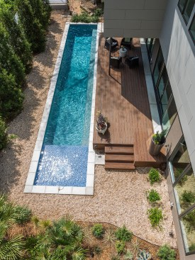 long-rectangular-swimming-pool-small-design-beside-terrace-house