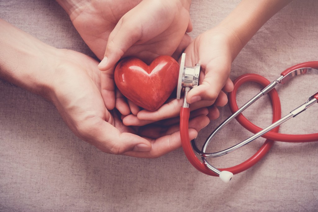 hands holding a stethoscope and heart representing supportive treatment centre