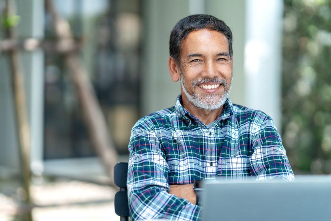 Man sits at his computer