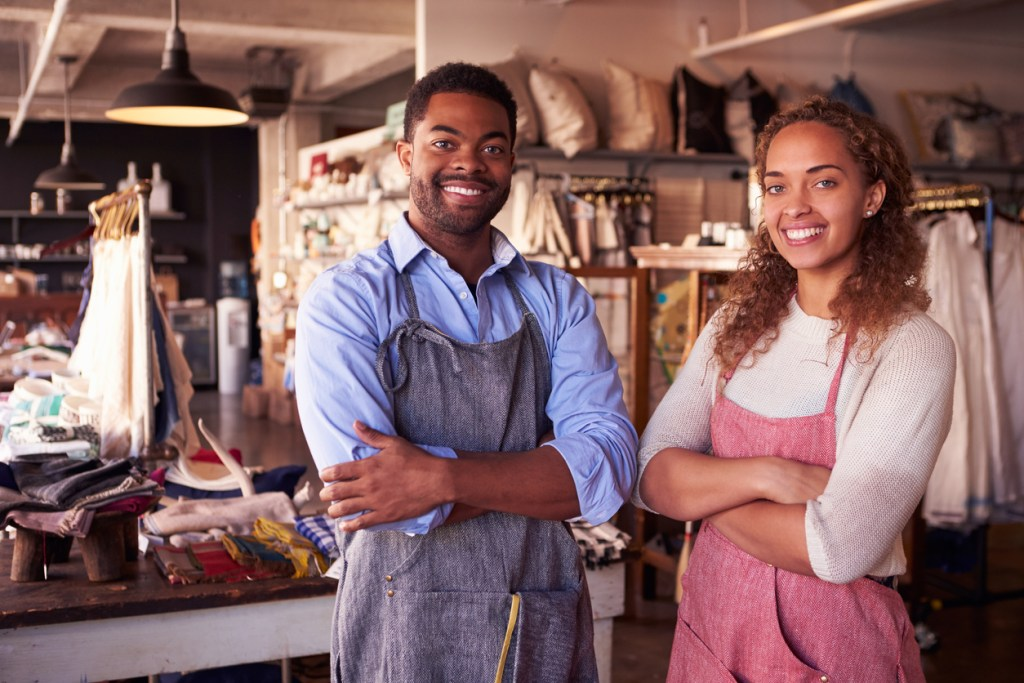 man and woman working in a store