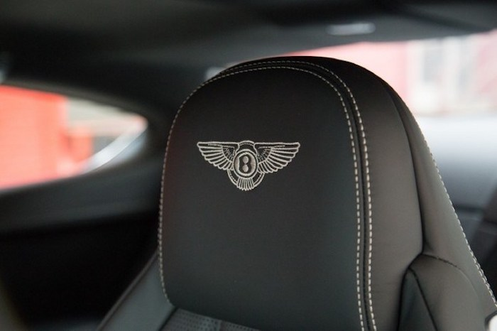 bentley car with an embroidered bentley logo on the driver´s seat