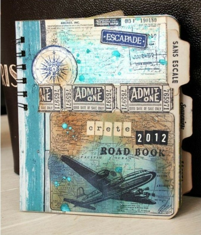 adventure journal, journal with vintage decoration, old tickets, map, airplane cutout, blue and yellow paint, compass