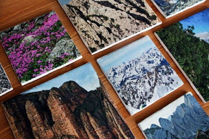 coasters made with beautiful nature photos, on a wooden table