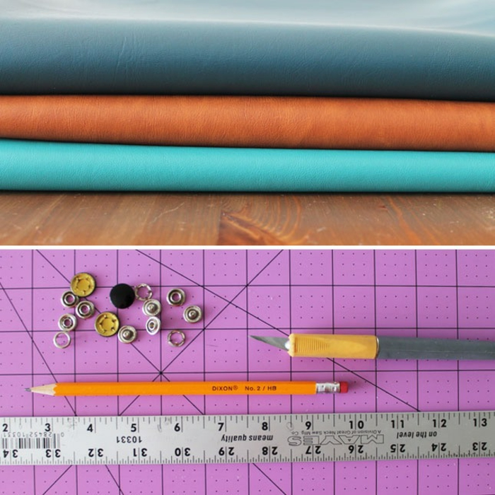 father's day diy gifts, three pieces of faux leather in dark blue, orange and turquoise, folded on a wooden table, a pink cutting board containing a pencil, a hobby knife, a metal ruler and some snap buttons