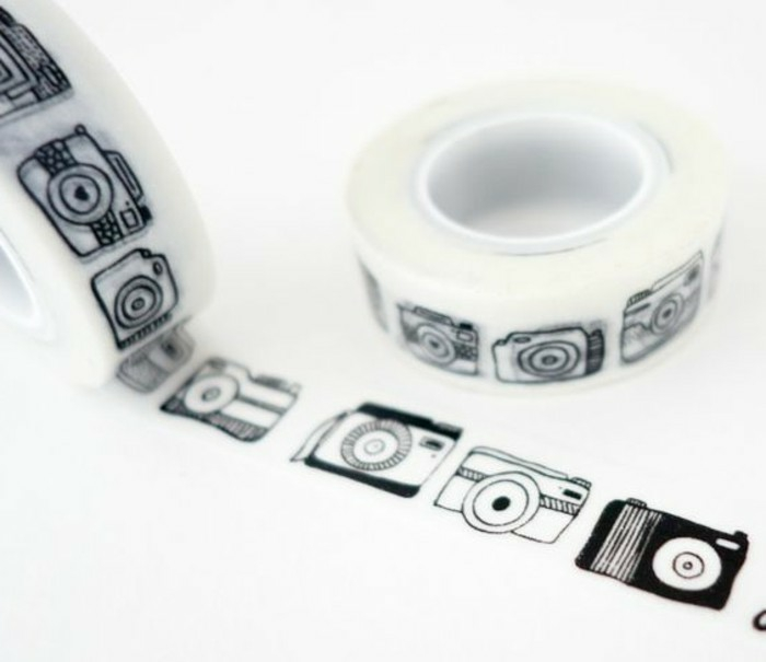 scrapbook ideas for beginners, decorative sticky tape with black camera design, two rolls, on white background
