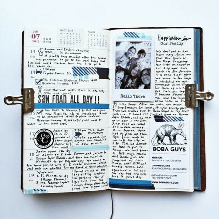 scrapbook page ideas, white background, open journal with blue details, a photo, a business card, lots of writing, dates, calendar