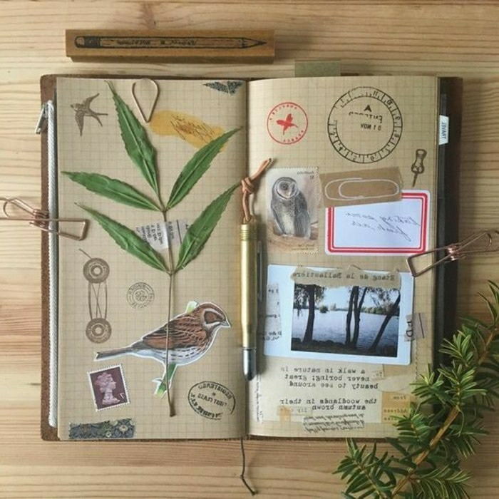 scrapbook page ideas, light brown squared paper in a journal, green leaves, photos, images of birds, stamps, a pencil