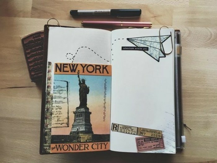 scrapbooking ideas, small sketchbook, white pages, vintage tickets, paper plane drawing, new york postcard, pens, wooden background