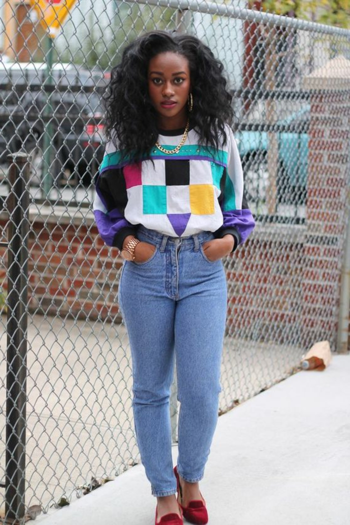 80's hip hop fashion, young black girl with mid length curly hair, wearing jumper with colorful geometric patterns, gold chain and rolex watch, light blue jeans and red loafers
