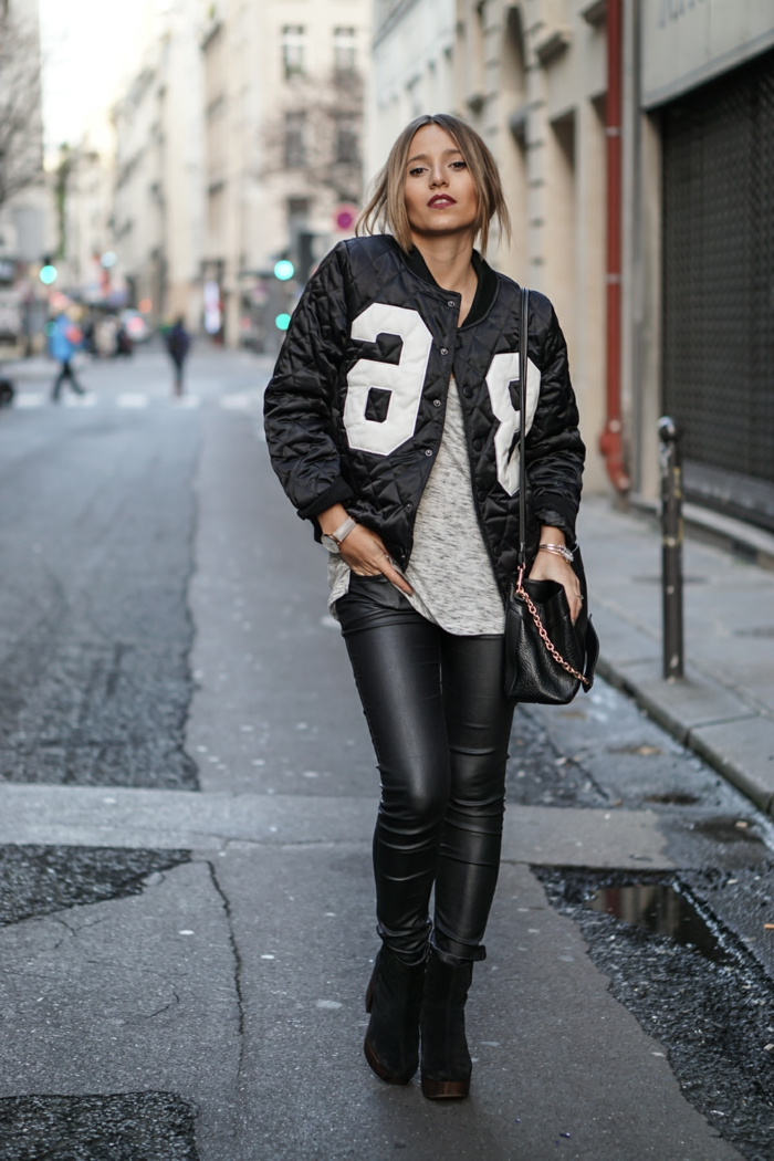 business casual for women, woman wearing skinny black leather trousers, grey top and bomber jacket