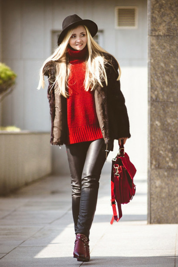 women's business attire, woman with long blond hair, wearing black leather trousers and chunky red sweater, with big leather coat and black hat, purple ankle boots and red bag