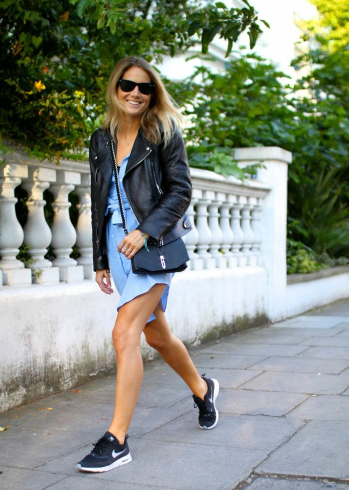 business casual dresses, smiling blonde woman with sunglasses, wearing pale blue mini dress, black sneakers and bag, black leather biker jacket