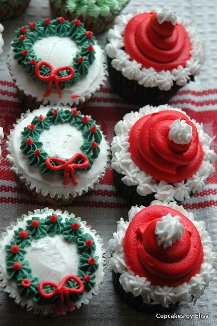 three vanilla cupcakes, frosted with white red and green, made to look like x-mas wreaths, three chocolate cupcakes, frosted with red and white, made to look like santa hats