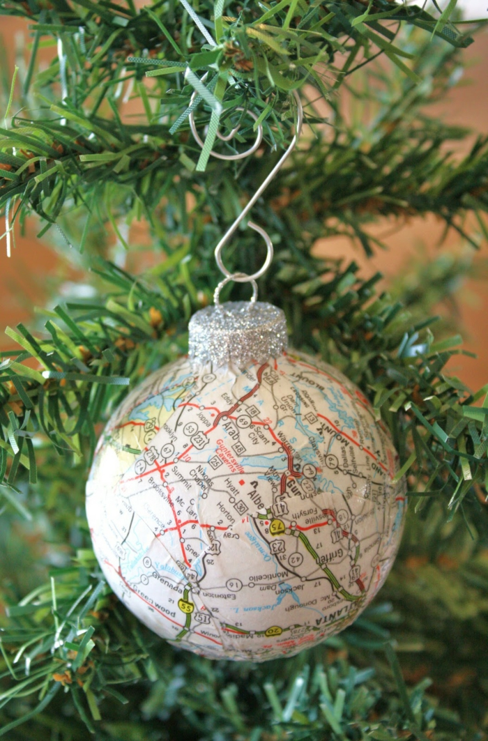 cheap christmas gift ideas, christmas bauble with silver glittering cap, decorated with a map, hanging from an xmas tree on a silver hook