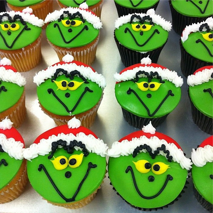holiday cupcakes, a batch of chocolate and vanilla cupcakes, with green and red fondant icing, decorated with yellow black and white frosting