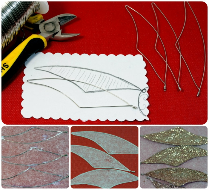 some wire and pliers with yellow and black handles, a piece of paper with a drawing of a simple wing, several wings made of wire, with added paper and golden glitter