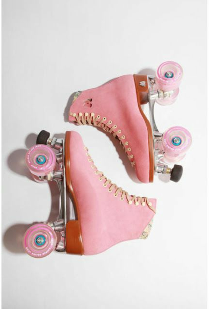 what did people wear in the 80s, pair of pink retro lace-up roller skates, pink wheels and peach colored laces, white background