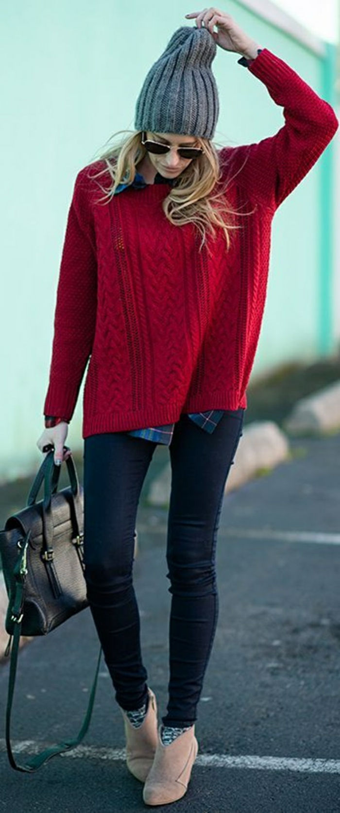 dark skinny jeans, big chunky red sweater and blue plaid shirt, light camel brown ankle boots and big grey beanie, worn by blonde woman with black leather bag