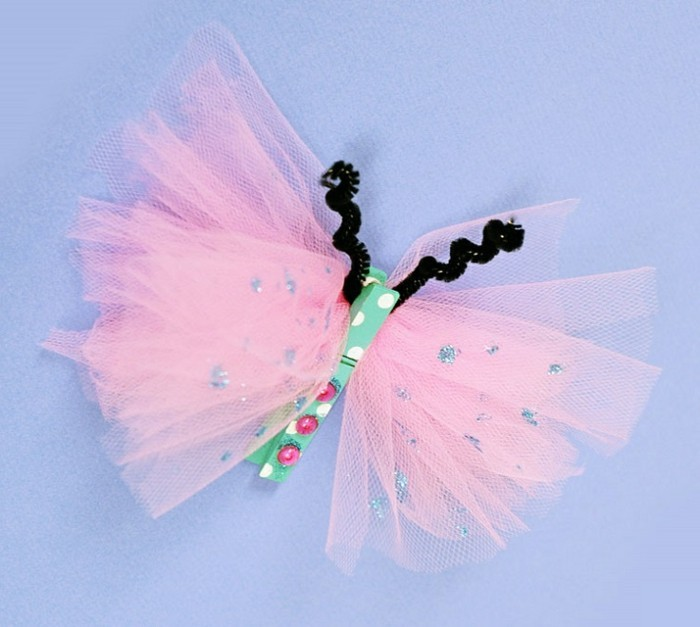 diy projects for kids, butterfly made from pale pink tulle, with silver sparkling details, multicolored clothes peg and fuzzy wire