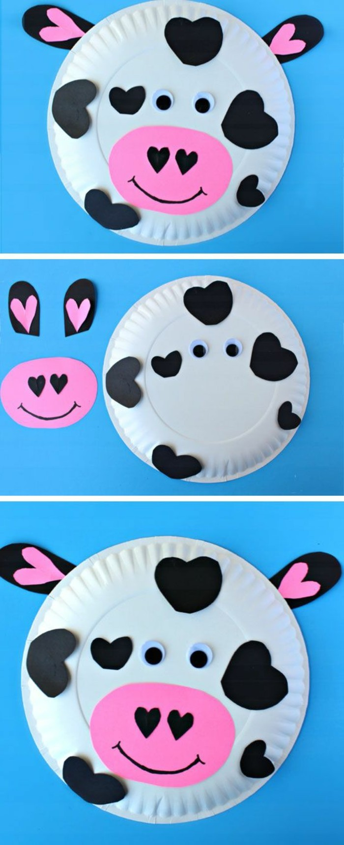 cow's face made from a white paper plate, decorated with pink and black paper cutouts, with stick-on eyes
