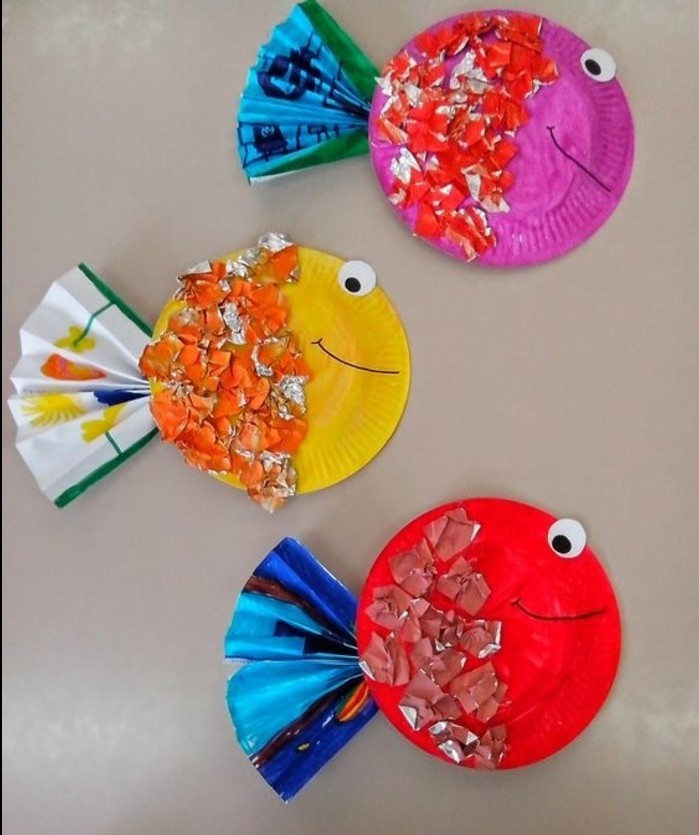 fun art projects, three paper plates painted to look like fish, decorated with paper shreds and folded paper details