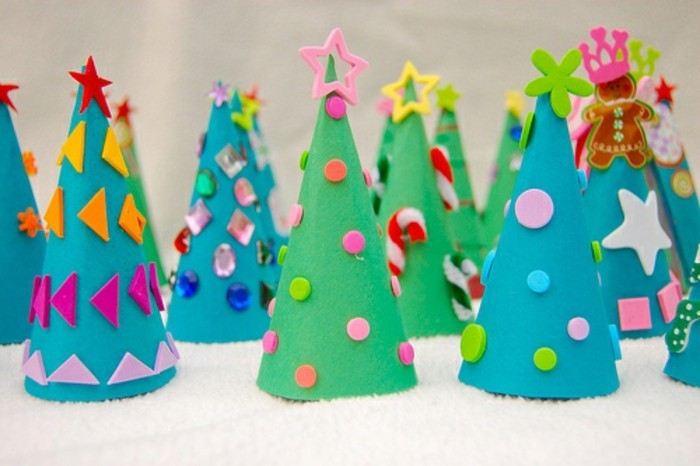 diys for your room, many christmas trees, made from green and blue felt, decorated with different cutouts, shapes and sticky shiny gems