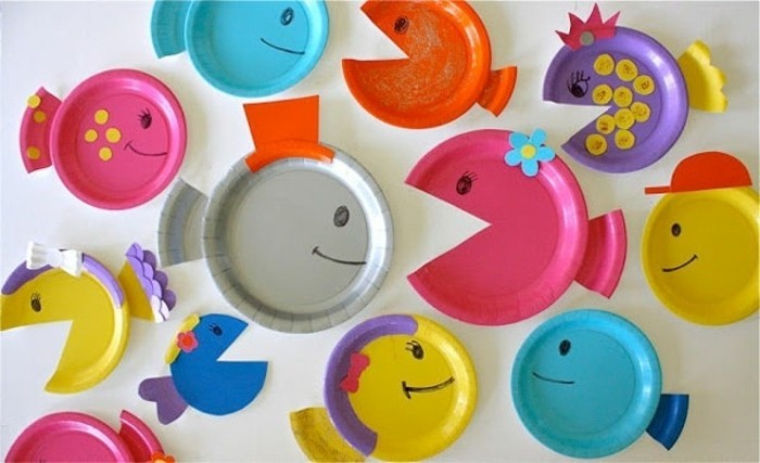 fun art projects, several paper plates in different colors, made to look like fish, decorated with colorful paper cutouts