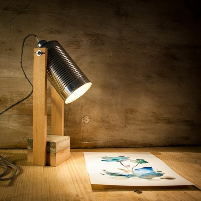 projector-like desk lamp, lamp made from wood and a tin can, shedding light on a watercolor drawing