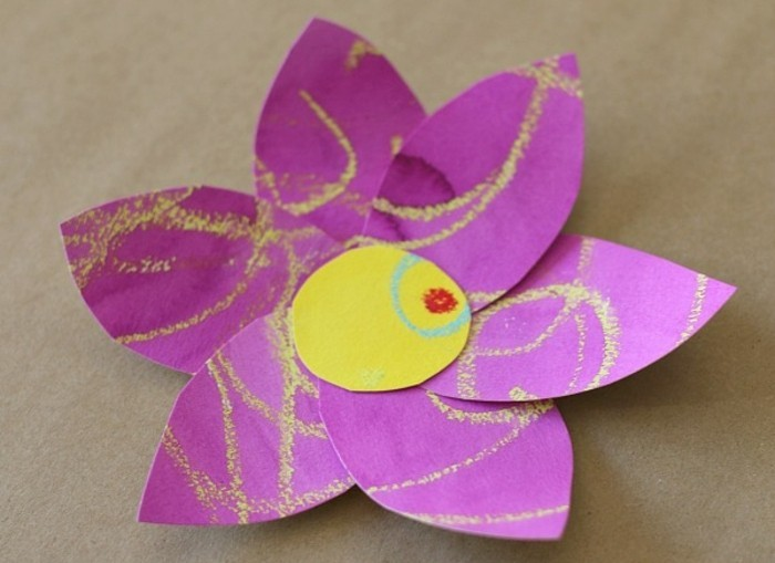 craft ideas for kids, large flower made of purple and yellow paper, decorated with yellow, blue and red scribbles