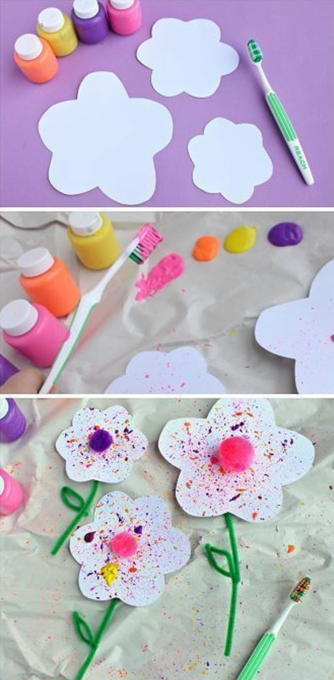 craft ideas for kids, four small bottles of paint, near flower-shaped cutouts and a green toothbrush, toothbrush dipped in paint and used over paper, finished flowers decorated with paint