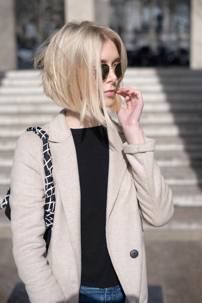 hairstyles for short hair, woman with short blonde bob, and black round sunglasses, wearing black top and light cream blazer