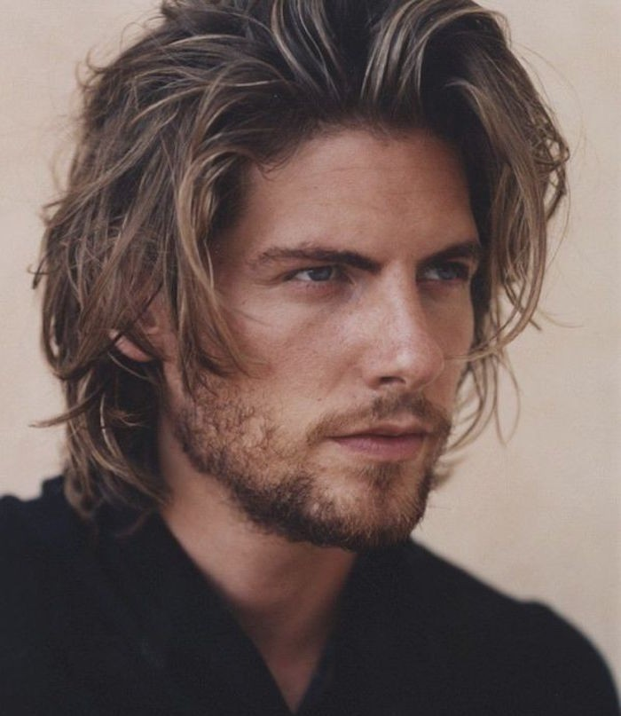 medium length hair, close up of dirty blond man, layered messy haircut and black shirt