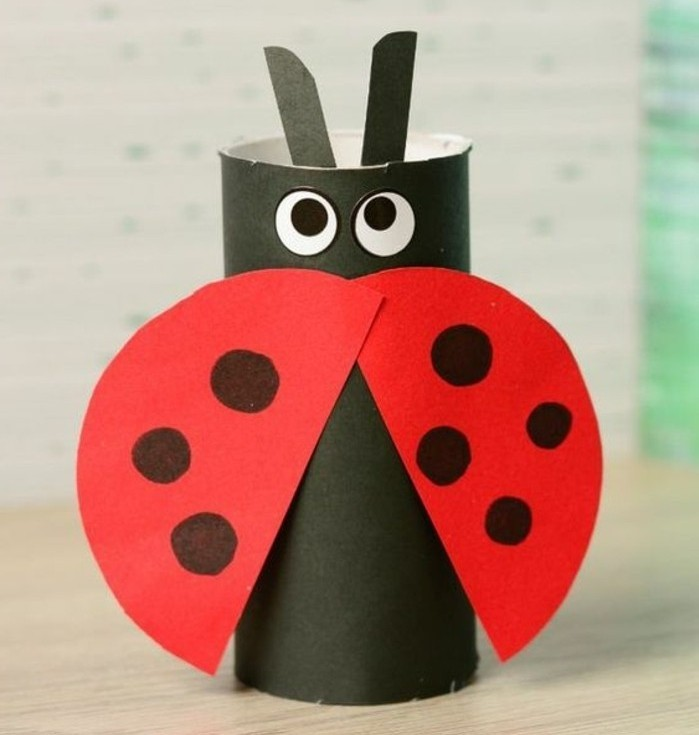 diy projects for kids, ladybug ornament made from black and red paper, decorated with stick-on eyes