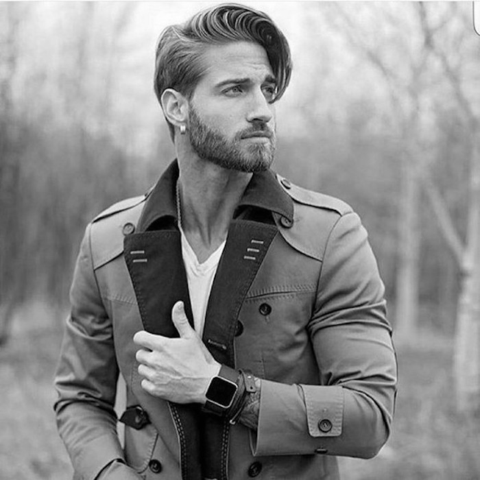 medium length hair, man with trench coat, short beard with mustache and earring, side-swept pompadour bangs
