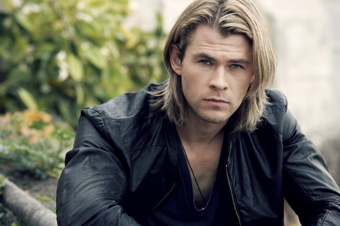 shoulder length hairstyles, blond man with black leather jacket, layered hair tucked behind one ear