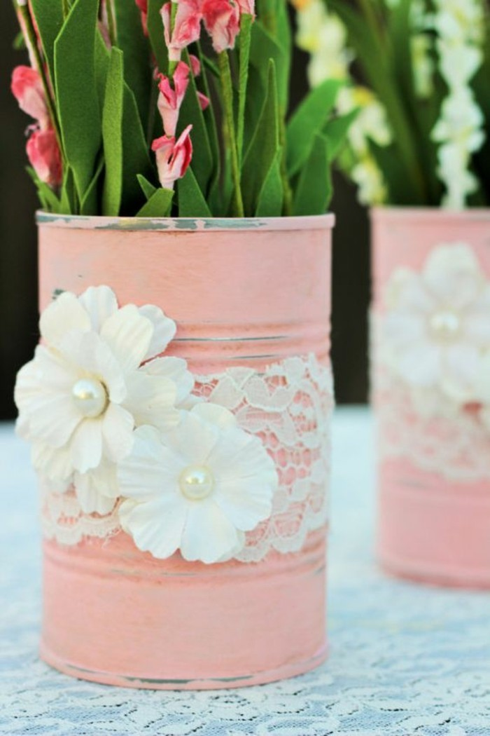 metal tin containers, close up of two cans, painted in pale pastel pink, decorated with lace and white fabric flowers, containing felt faux flowers