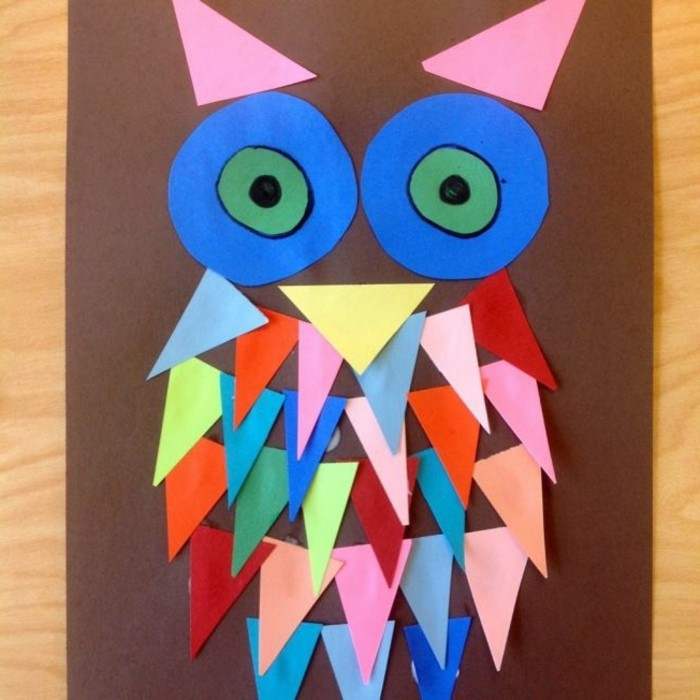 owl collage on brown paper, made from triangular and circular paper shapes in different colors