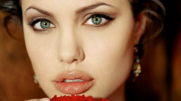 rarest eye color, close up of angelina jolie, with large green eyes, big lips with natural lipstick, eyeliner and simple, natural make up