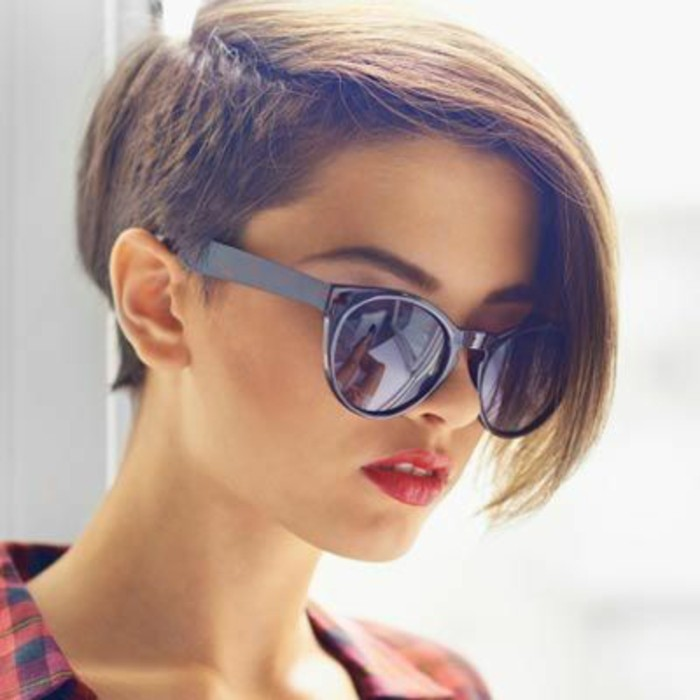 cute hairstyles, young woman with hair cut short on one side, and kept long on the other, wearing sunglasses and bright red lipstick