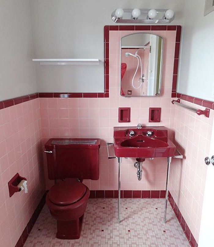 bathroom decor ideas, vintage style toilet, white walls partially covered with pale pink and dark red tiles, antique dark red toilet seat and sink