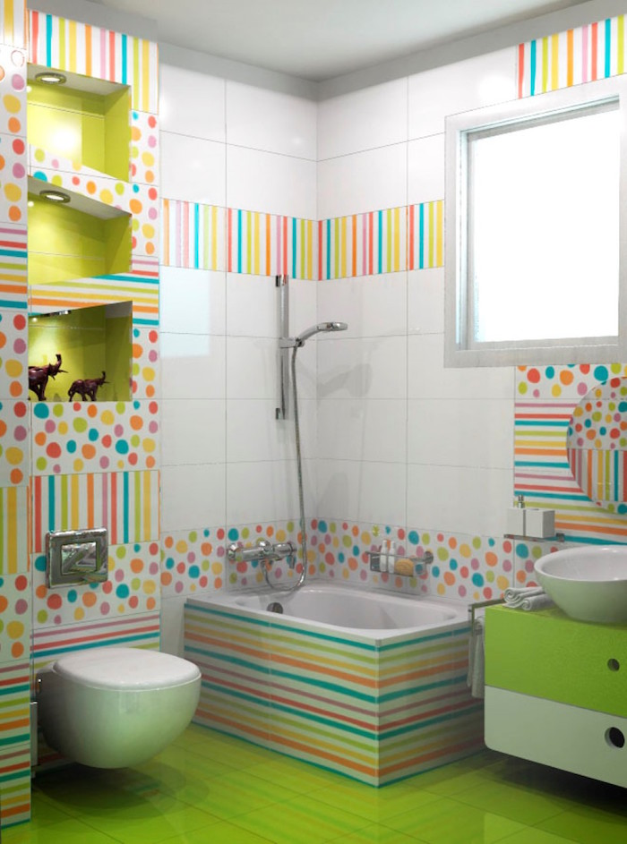 bathroom ideas, acid green tiles on floor, white tiles on walls, decorative tiles with multicolored dots and stripes, white toilet seat, small inbuilt tub, green cupboard with white sink, asymmetrical display shelves