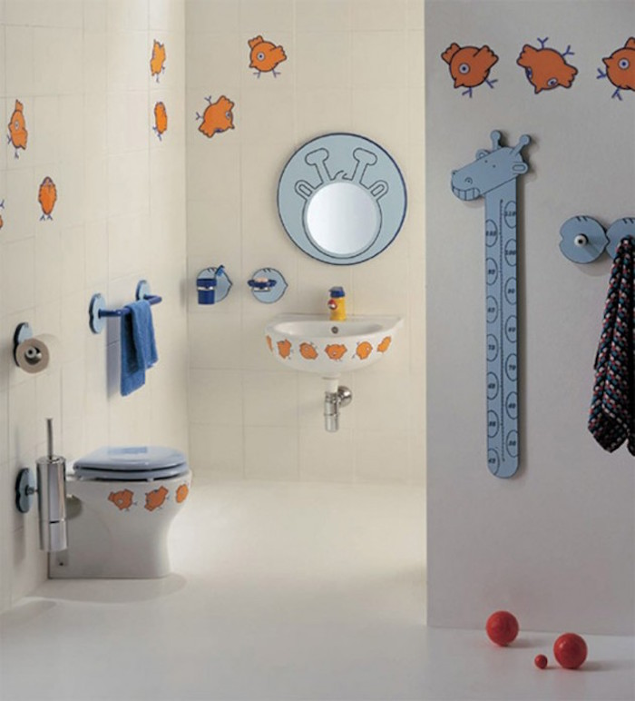 bathroom decor ideas, spacious kids' bathroom, with white tiled walls, several tiles contain cartoon drawings of yellow chicks, small toilet seat, with chick drawings and pale blue cover, round wall mirror with pale blue frame