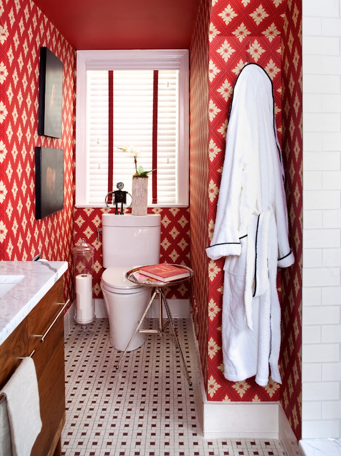 small bathroom ideas, toilet with red and white patterned wallpaper, floor with small mosaic tiles, wooden cupboard with white sink, white toilet seat and window with blinds