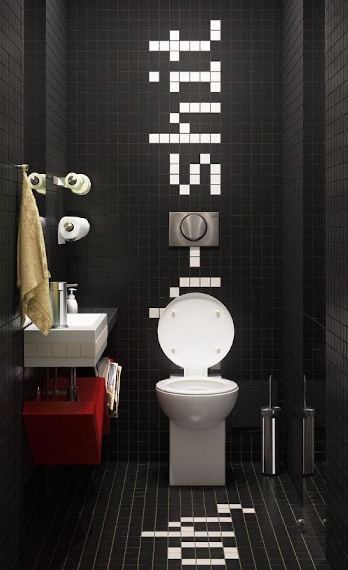 bathroom decorating ideas, bathroom with high ceiling, entirely covered in small black tiles, with a humorous message written sideways with white tiles, oval white toilet seat and square, black and white sink