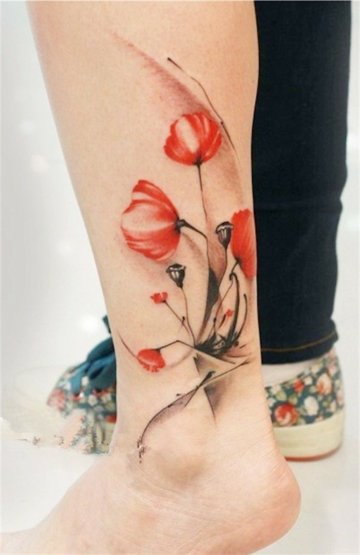 red and black, watercolor-effect tattoo, of several poppies, with dark bending stalks, on a person's ankle