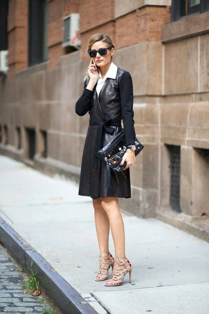 business casual women, olivia palermo with tied back blonde hair, wearing black leather wrap-over dress, with textile sleeves and belt