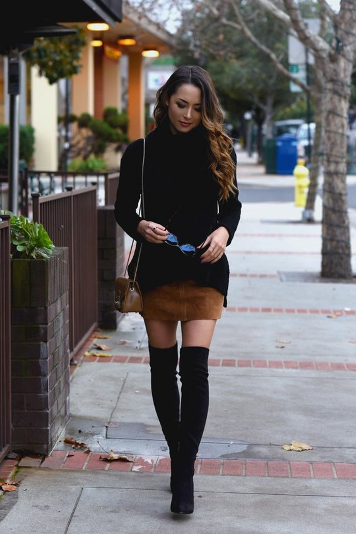 casual dress code, woman with brown and blonde ombre hair, wearing black turtleneck sweater, over beige suede mini skirt, with black over the knee boots, and small brown shoulder bag